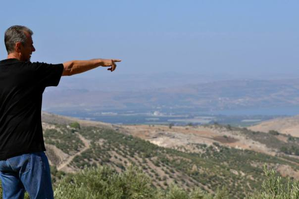 Ron pointing toward the south part of the Sea of Galilee on the Jordanian/Israeli border in the north