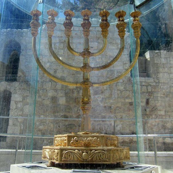 Gold reconstruction of the Temple Menorah stands now near the Western Wall in Jerusalem.