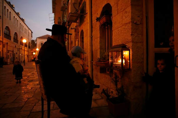 Streets of the Jewish Quarter as the sun sets on Hanukkah.